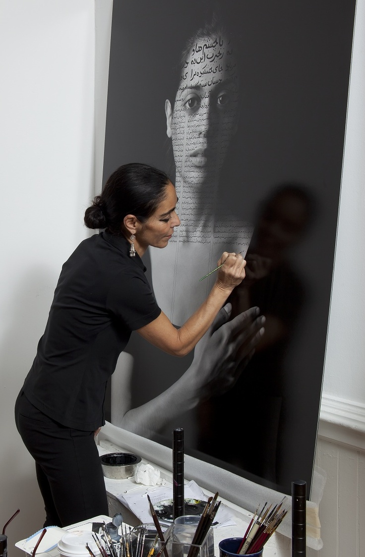 A mid-career retrospective of Shirin Neshat, 2013. Shirin in her studio working on Roja from The Book of Kings series, Photo: David Regen