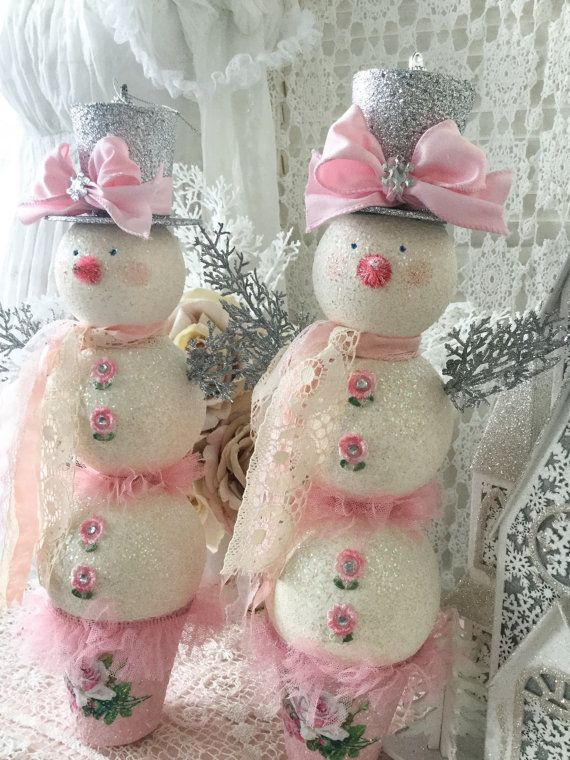 This charming shabby pink snowman would make a welcome addition to your romantic cottage chic style Christmas decor ! Darling one-of-a-kind snowman is all bundled up with her pretty silver glittery top hat and ivory lace and pink ribbon scarf around her neck. She is adorned with little