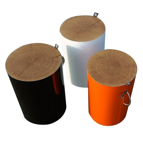 TREE STUMP - MALAFOR  Seat made of oak wood covered with metal sheet (it can be polished, reflective or painted in variety of colours). STUMP has a handle for easy carrying.