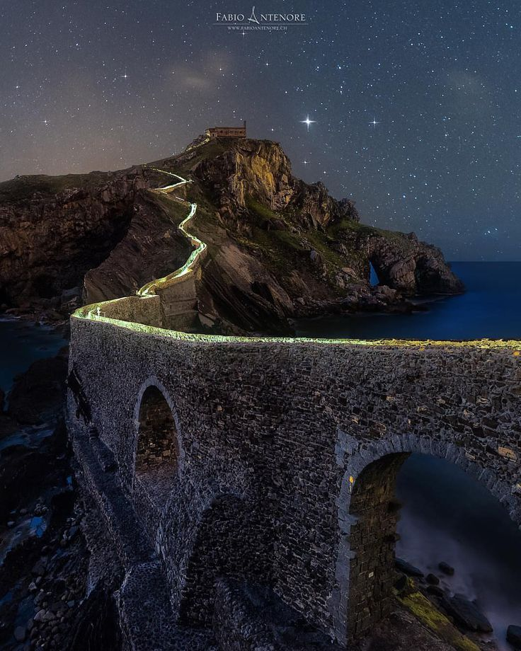 "presents the  N I G H T S C A P E R Photo Award to ... .  @antenorefabio .  San Juan De Gaztelugatxe Spain (Game of Thrones location). Congratulations to Fabio Antenore. This is a new edited version of my speedline picture. I had to run the whole stairways with my headlight on my heada 6 minute stairway run says Fabio! || Please show support to our guest artists by visiting their IG gallery . .  SHOWCASE Your Photo Here: To have your ""Night Photography"" considered for a feature in this…"