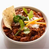 Black Bean Turkey Chili - Jillian Michael's •1 pound ground turkey cup onion,   red bell pepper,   garlic,   jalapeno peppers, chili powder, ground cumin,  red pepper flakes,  ground cinnamon  canned, tomatoes (1 diced, 1 sauce) black beans, rinsed and well drained    shredded cheddar cheese