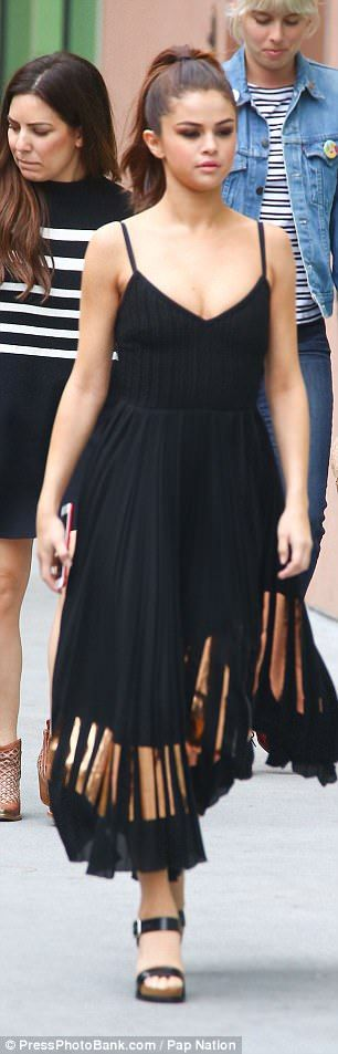 Simply chic: Black heels and bronze details on the dress gave Selena's look the perfect bit of glamour
