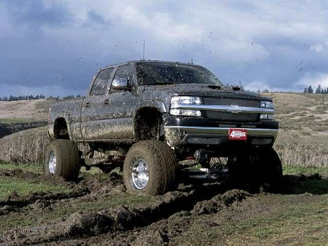 jacked up chevy trucks mudding - photo #14
