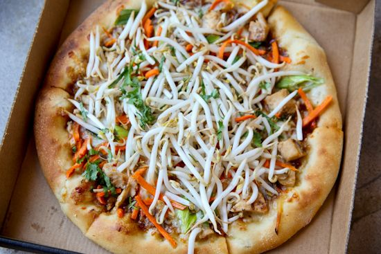 CopyCat CPK Thai Chicken Pizza- {notes from Mer} this was delicious! It was a little time intensive with the homemade dough, peanut sauce, and chopping.... but it was worth every second of prep work.  I would suggest putting on the bean sprouts and cilantro the last two minutes of cooking time rather than at the beginning. Make note that it makes two large pizzas. MJ