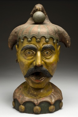 Carved wooden apothecary sign, Europe, 1750-1850. This sign in the shape of a jester's head once hung outside an apothecary's shop, somewhere in Europe