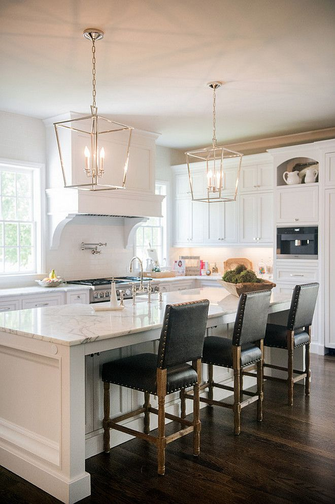 Stunning White Kitchen With Silver Lanterns And Dark Leather Barstools