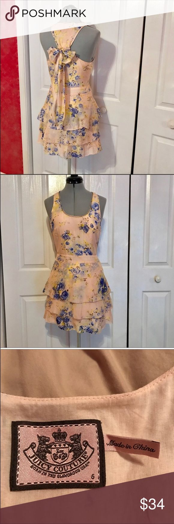 """Juicy couture dress Juicy couture dress. Blush with floral design. Tiered skirt. 76% cotton 24% silk. Racer style back with large bow. Approximate bust measurement is 36"""". Hips 38"""". Juicy Couture Dresses"""