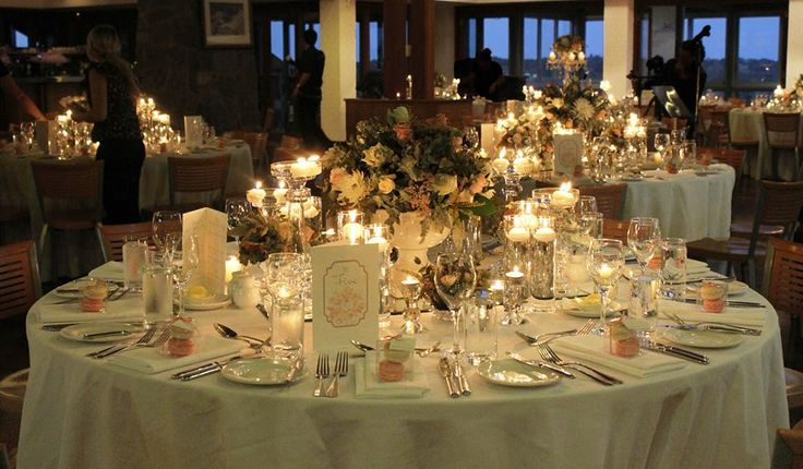 Antique coloured florals and a myriad of candle light set the scene for Kyle & Danielle's special evening.