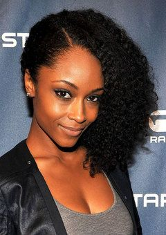 Yaya DaCosta's Side-Swept Natural Curls. To learn how to grow your hair longer click here - http://blackhair.cc/1jSY2ux