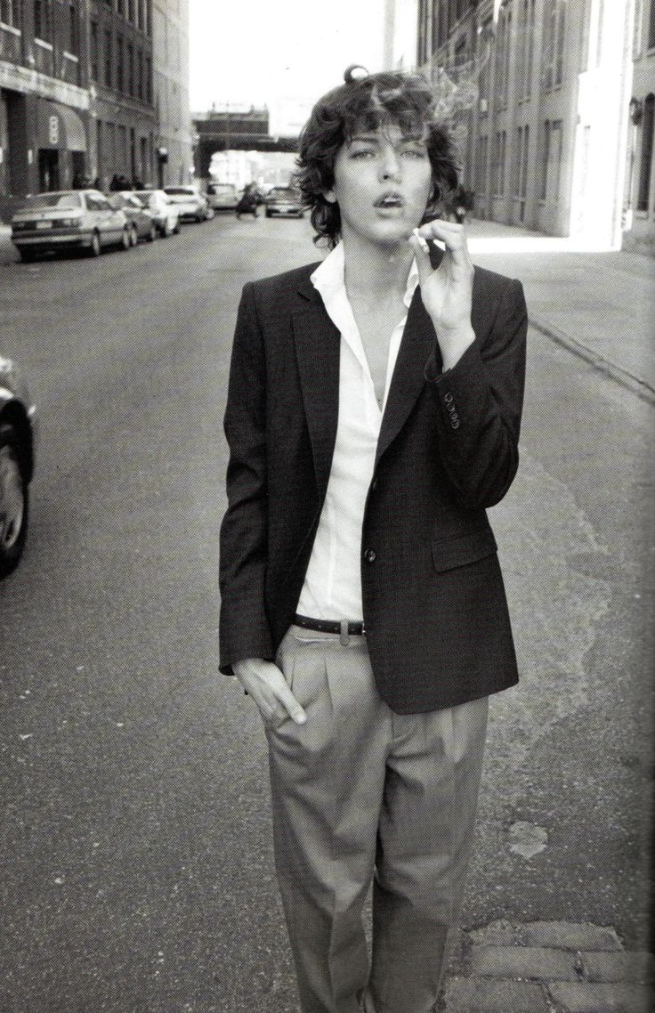 Milla Jovovich for Alberto Biani, circa 1997. Androgyny was a provocative, recurring theme in the 1990s. Suddenly genders were not separate, with hard edges where one ended and the other began — they could blend into each other. And the overlap was attractive. Here Jovovich looks like a young Bob Dylan, albeit more goodlooking, in a crisp pinstriped jacket and pleated pants.