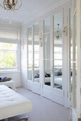 Lovely mirrored wardrobes.