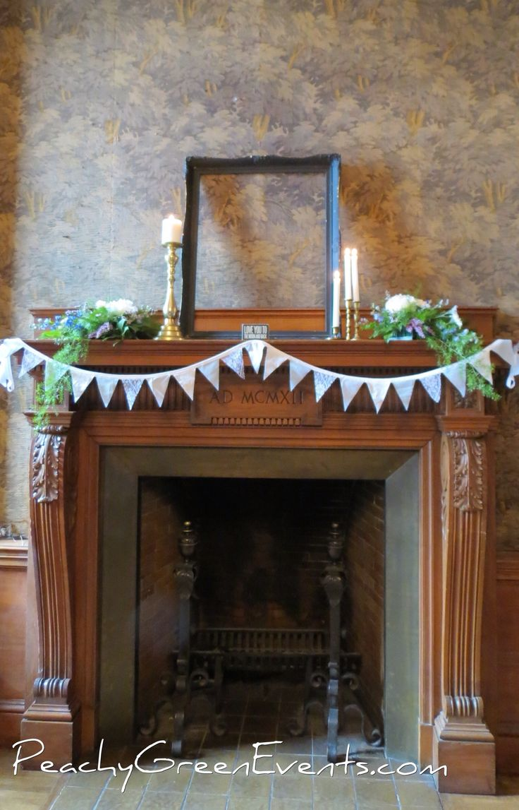 Fire place decor for a wedding in the historic Exchange District in Downtown Winnipeg. Lace bunting, vintage brass candle holders, vintage frame and trailing florals.