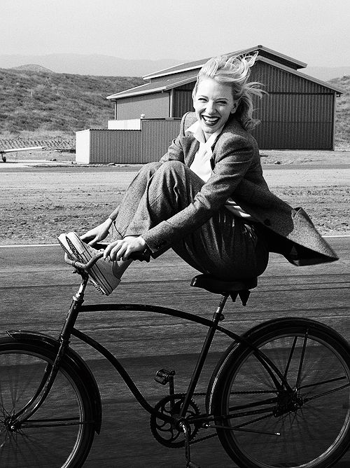 Cate Blanchett by Annie Leibovitz  I love that this photograph is in black and white. The composition is fun and alive, bringing out a joyful emotion which makes the photograph a lot more appealing in my opinion.  This shot looks like it was taken when she was actually speeding along the path on her bike, which gives the photo a bit more action as you can see her hair blowing in the wind.