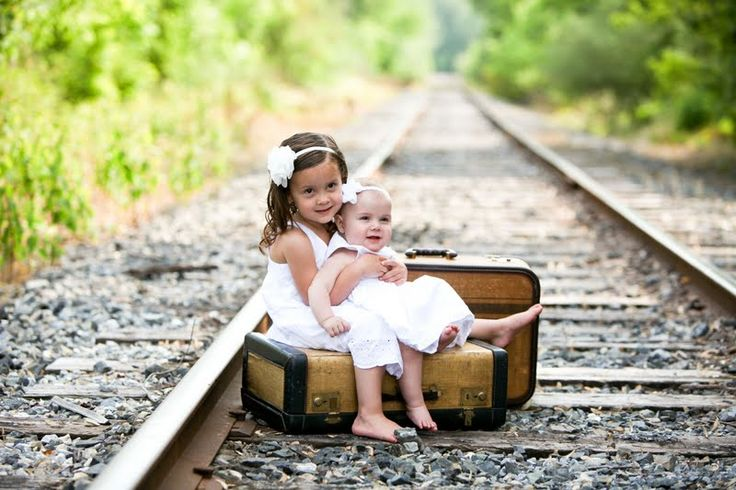 train track poses for photo | ... : Little Girls , white dresses + railroad tracks = more cuteness