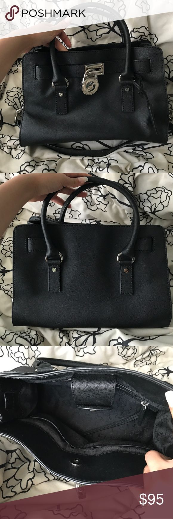 Black Michael Kors Tote/Shoulder Bag Used but still in good condition. It's a medium sized bag, not too big but not too small, you can definitely fit a lot of things in it. It has a strap with chains at the end of it that u can wear on your shoulders or arms. I've used it maybe less than 5 times, I loved the purse at first but I don't use it anymore Michael Kors Bags Shoulder Bags