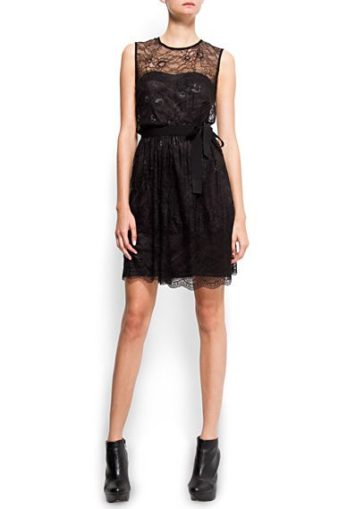 Sleeveless cocktail dress with round neck, lace top layer, strapless interior lining, grosgrain ribbon at waist and tear drop fastening at back.