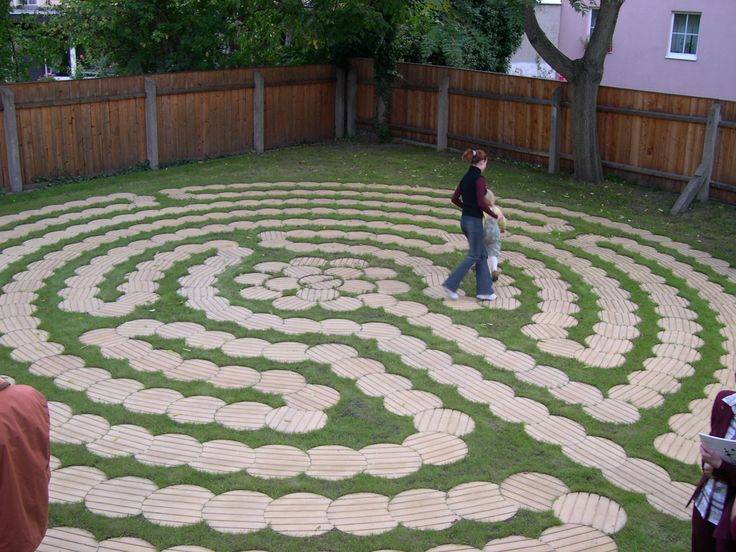 Labyrinth made of round wooden boards cut just right nice for Garden maze designs