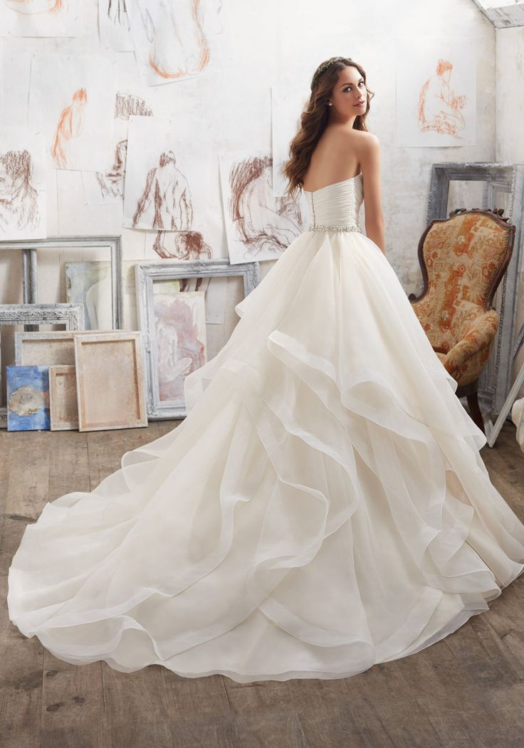 Morilee by Madeline Gardner 'Marissa' 5504 | This Dreamy Organza Ballgown Features a Flounced Skirt with Horsehair Trim. Removable Crystal Beaded Satin Belt Included (Crystal Beaded Satin Belt Also Sold Separately as Style #11254). Available in Three Lengths: 55″, 58″, 61″. Colors Available: White, Ivory