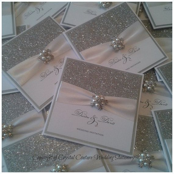 Stunning invitations designed with glitz and glamour in mind. These white linen pocketfold invitations are layered with a silver pearlescent
