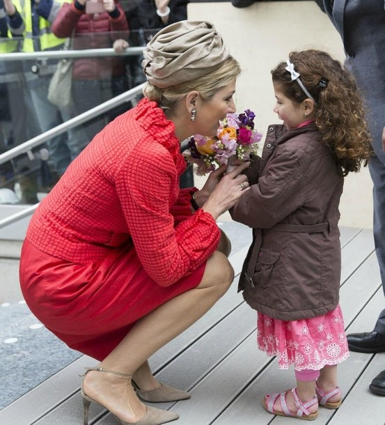 Queen Maxima of The Netherlands is welcomed by five-year-old kidney patient Dikra Karrat who presents her with flowers during 150th Anniversary Of Sophia Childrens Hospital