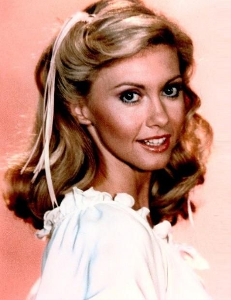 Although Olivia Newton-John lives in Australia, she was born September 26, 1948 in Cambridge, England.  Newton-John was her family name at birth.  She did not acquire this name through marriage.   She has won world wide fame as Sandy Olsen in the musical film Grease.    Read the full story>>