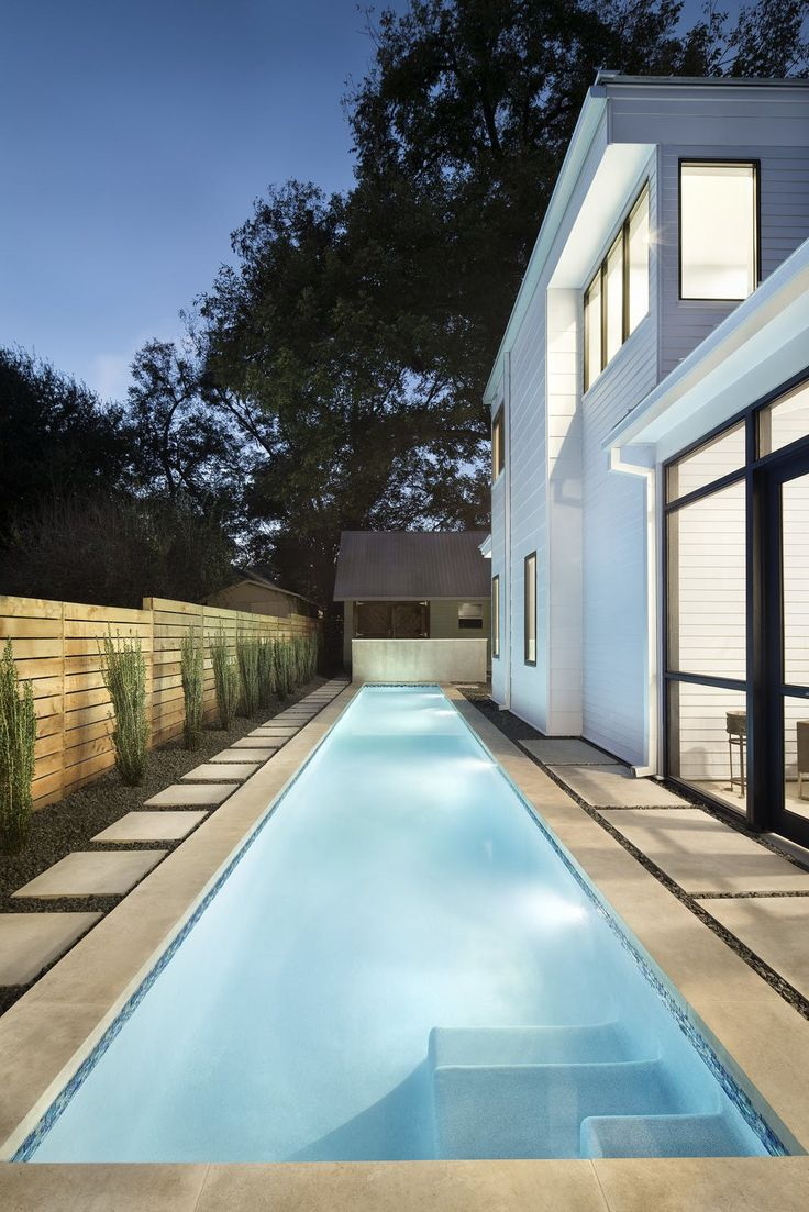 A lap pool tucks into the side yard of an Austin home from Dwell.