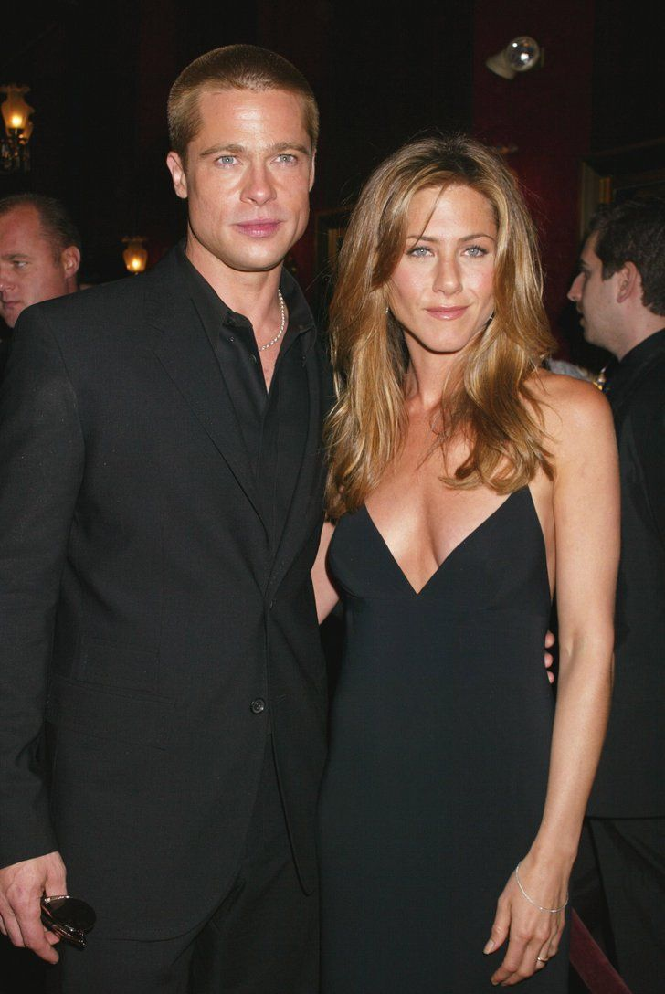 Pin for Later: 52 Years of Epic Brad Pitt Hotness  Brad and Jennifer were clad in black for the NYC premiere of Troy in May 2004.