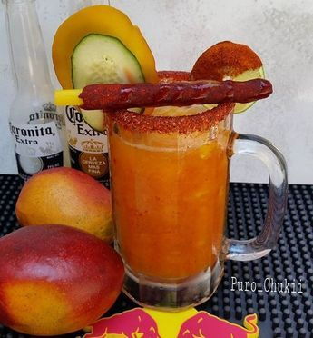 Mango Michelada: INGREDIENTS: Ice 1/2 cup of fresh mango puree 1oz. freshly squeezed lime juice 1 (12-ounce) chilled Mexican beer 1 lime Coarse salt Chamoy sauce Hot sauce (optional) Fresh mango, cucumber slices and a tamarind straw for garnish.