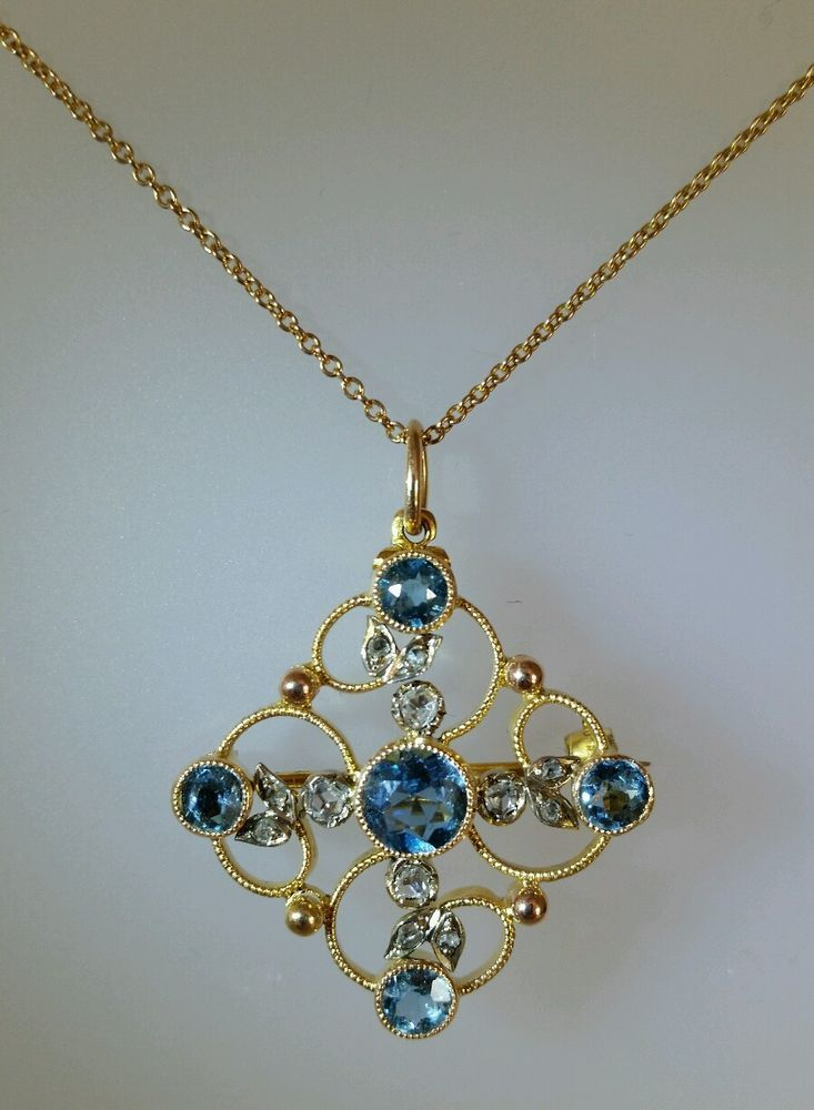 Victorian open work gold pendant / brooch. Collet Set with Blue Topaz & Diamonds