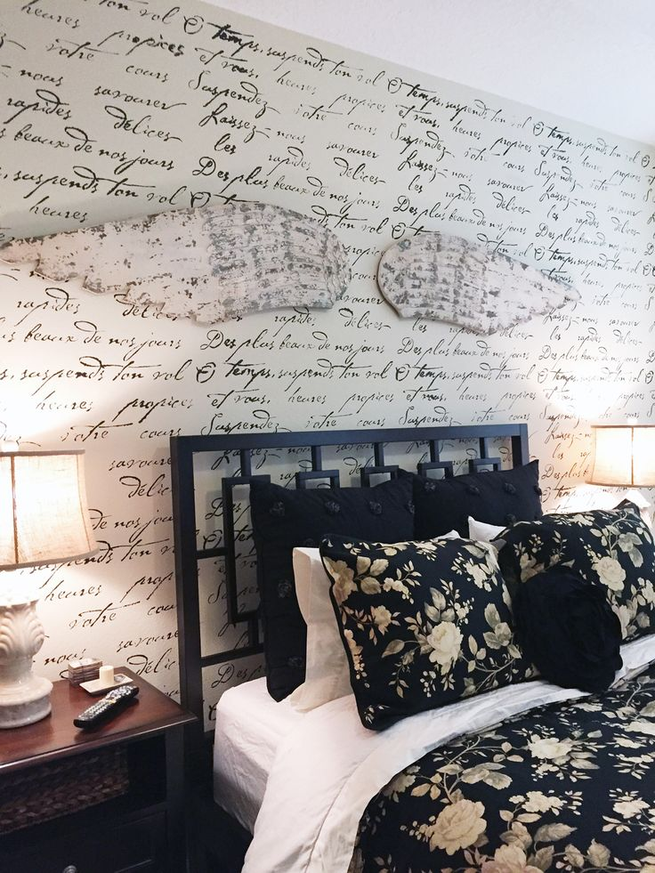 A black and white DIY stenciled master bedroom accent wall using the French Poem Allover Stencil from Cutting Edge Stencils. http://www.cuttingedgestencils.com/french-typography-letter-wall-stencil.html