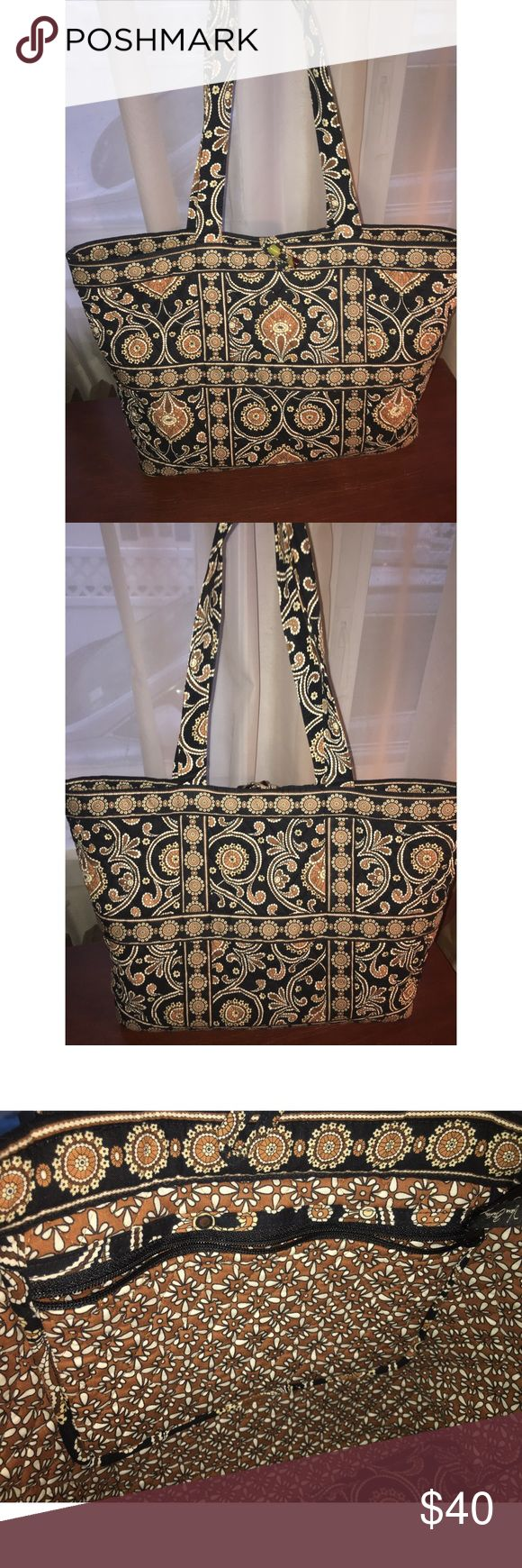 Vera Bradley RETIRED Caffé Latte Tote Bag Caffé Latte Vera Bradley Tote Bag! *RETIRED PRINT!! Great condition! Very gently used. 15.5 in along the (hard) bottom, 12.25 in height and 11.25 is the height of the handle. When the bag is fully open it is 14 inches wide. Toggle close. Two small pockets, one big zipper pocket. Vera Bradley Bags Totes