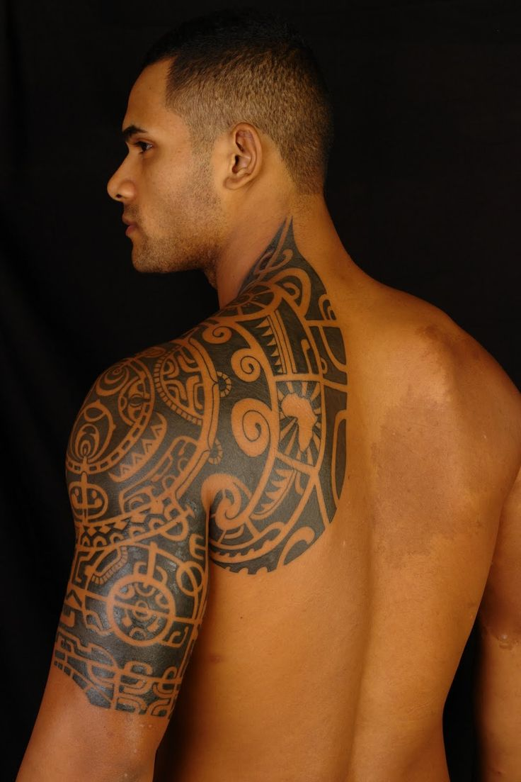 Polynesian tattoo on arm and chest - 55 Awesome Shoulder Tattoos