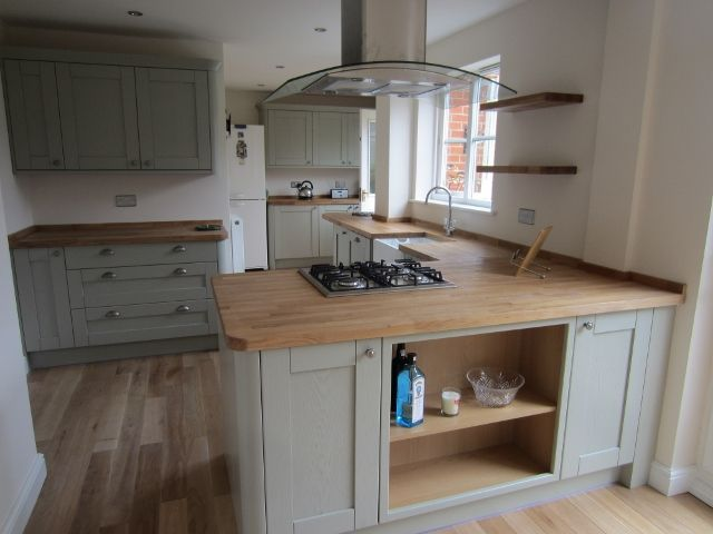 Nice colour cabinets- wood worktop with wooden flooring works. Tewkesbury Sky howdens
