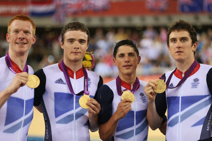 (L-R) Edward Clancy, Steven Burke, Peter Kennaugh and Geraint Thomas celebrate with their gold medals during the medal ceremony for the Men's Team Pursuit Track Cycling final     (Photo by Bryn Lennon/Getty Images) 2012 Getty Images