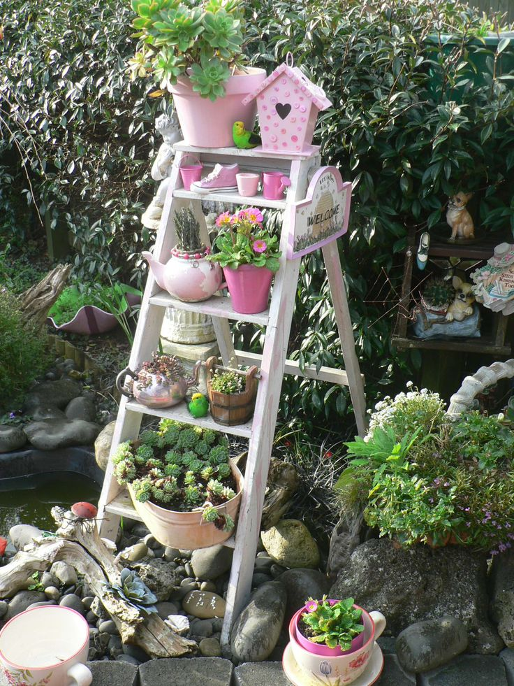 Old ladder garden idea.  Put grand kids potted plants on the ladder in the secret garden.