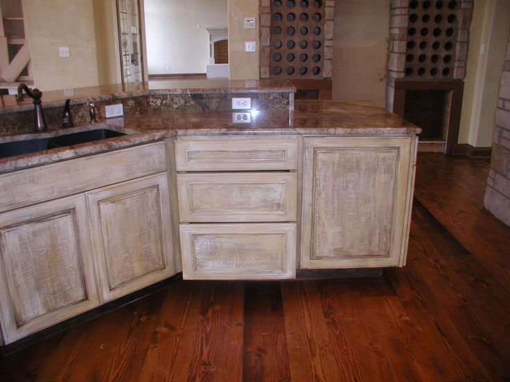 Distressed white kitchen cabinets kitchen cabinets white for Looking for kitchen