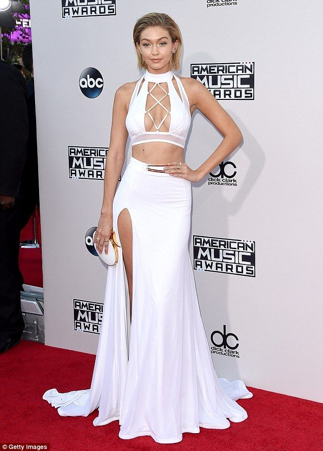 Gigi Hadid @ AMAs 2015  #AMA #AMAs Va va voom: Her white two-piece dress surely turned heads on the red carpet