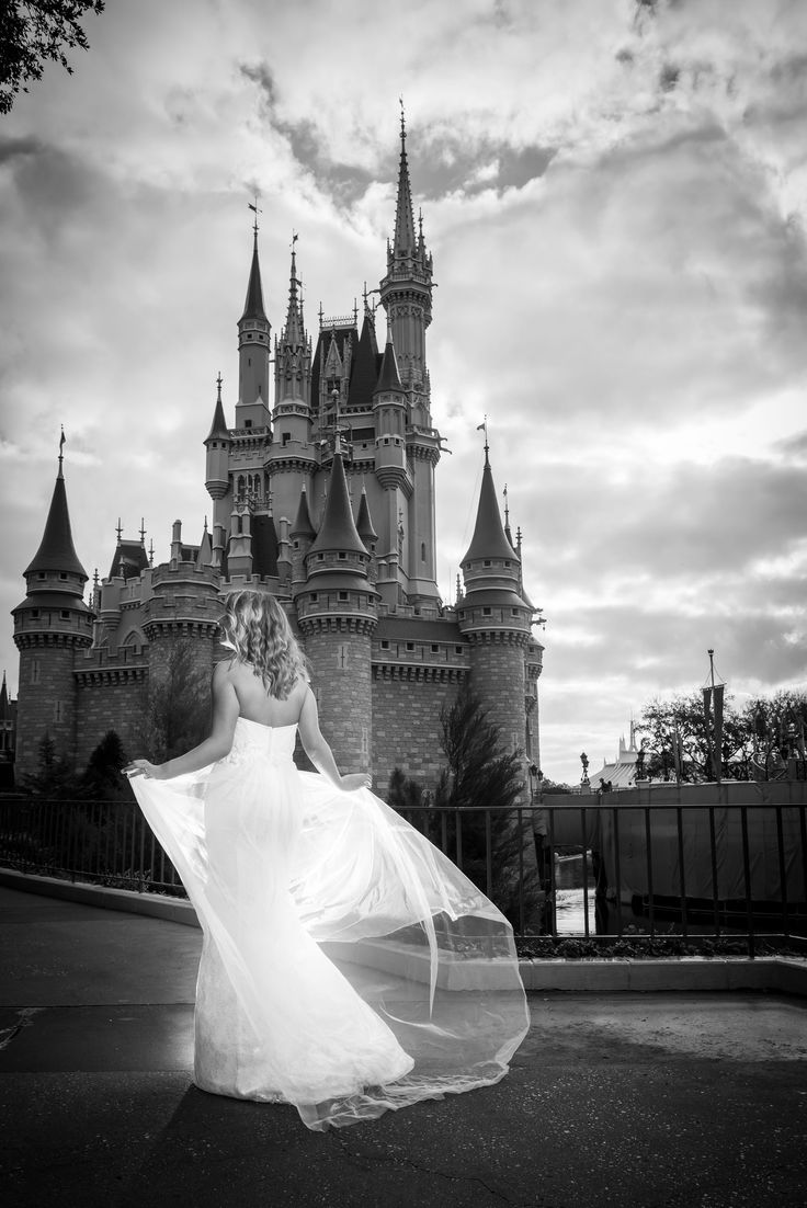 We are loving this shot of a gorgeous Disney bride at Magic Kingdom. Photo: Jacob, Disney Fine Art Photography