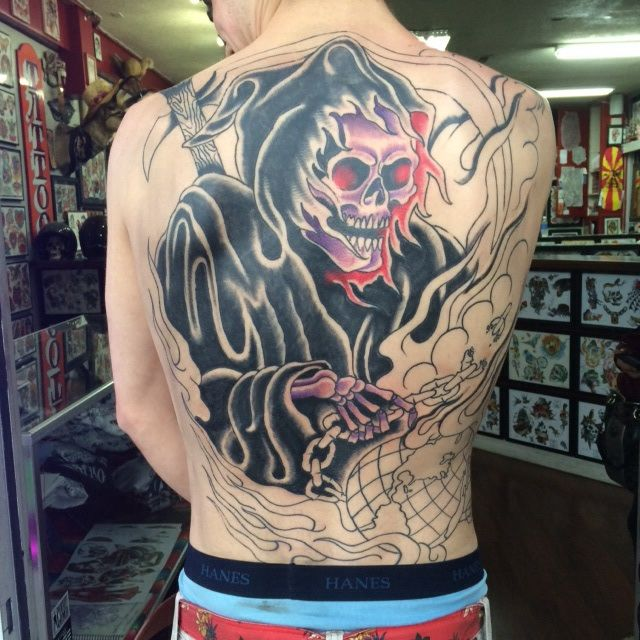 Back piece tattoo of a grim reaper holding the world for Sailors grave tattoo gallery