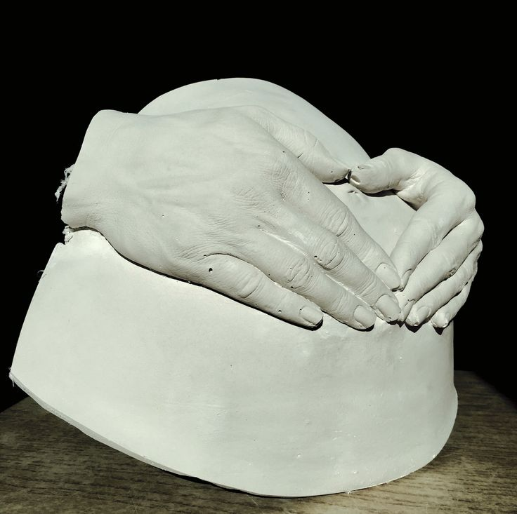 Some different work, plaster cast of hands on pregnancy belly