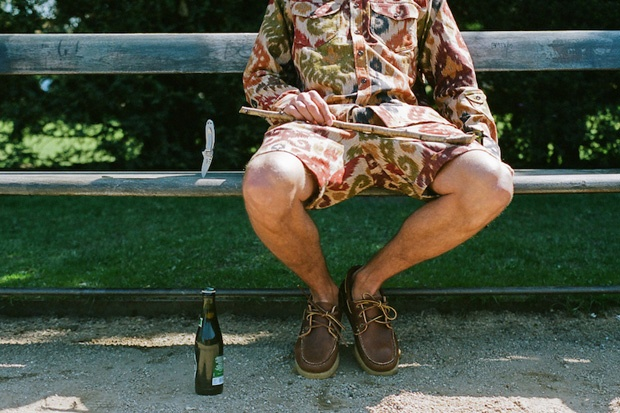 Printed earth tone jacket and similar printed shorts. Brown crepe soled moccasins or dark brown boat shoes. Pocket knife and a bottle of brew.  Norse Store 2011 Spring/Summer Lookbook | Hypebeast