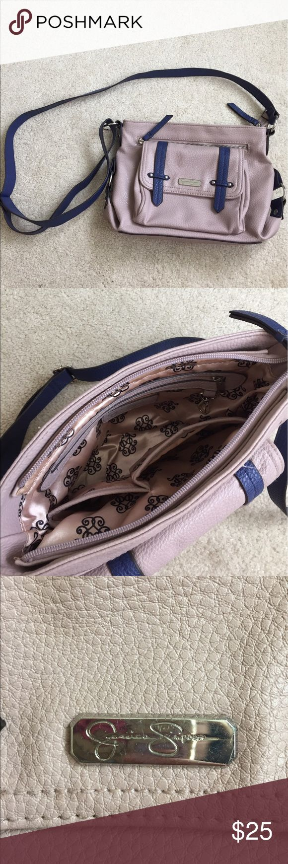 Purse This cross body is lightly used but still super cute and in great condition. Has an adjustable strap and 4 pockets. Willing to accept offers. Jessica Simpson Bags Crossbody Bags