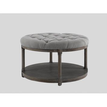 Love this round ottoman/coffee table, just not the price.
