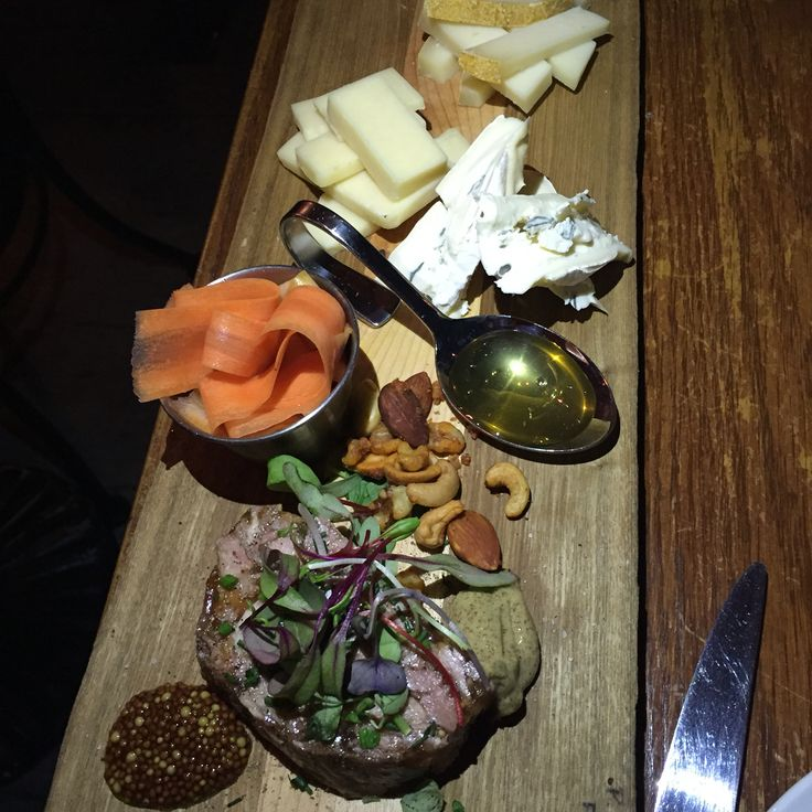 A gorgeous board of pulled pork terrine, pickled carrot ribbons and Ontario cheeses.