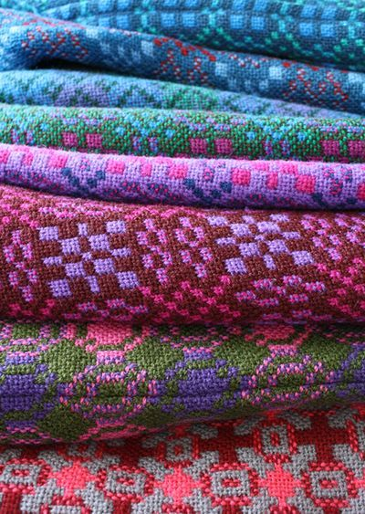 Somebody's collection of Welsh tapestry coats!  From one of my new favorite blogs, laughing yaffle....