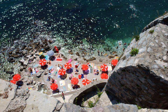 Colourful parasols on the beach at Herceg Novi in Montenegro