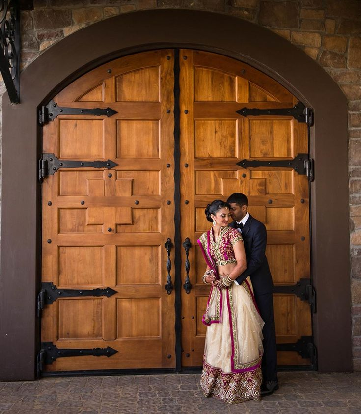 A beautiful cream colored lehenga with a purplish border and a matching blouse from Roopkala for Naomi of WeddingSutra.