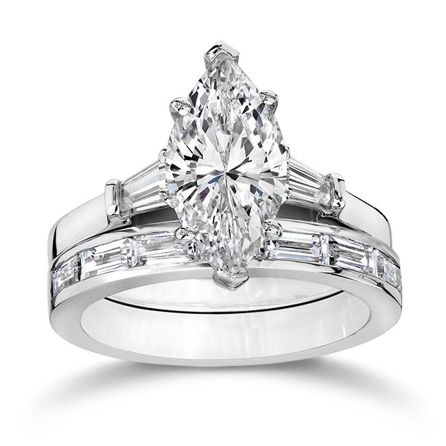 So a raised center diamond does allow for a straight band underneath. My brilliant jeweler was right! marquise diamond ring with round and baguettes - Google Search