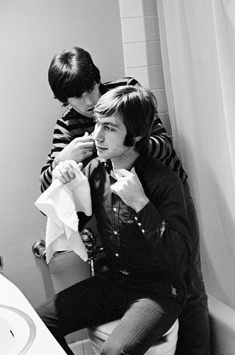 Keith Richards gives Charlie Watts a haircut backstage before their appearance on the Hullabaloo TV Show, November 11, 1965. | Rare and Intimate Pictures of the Rolling Stones | Rolling Stone