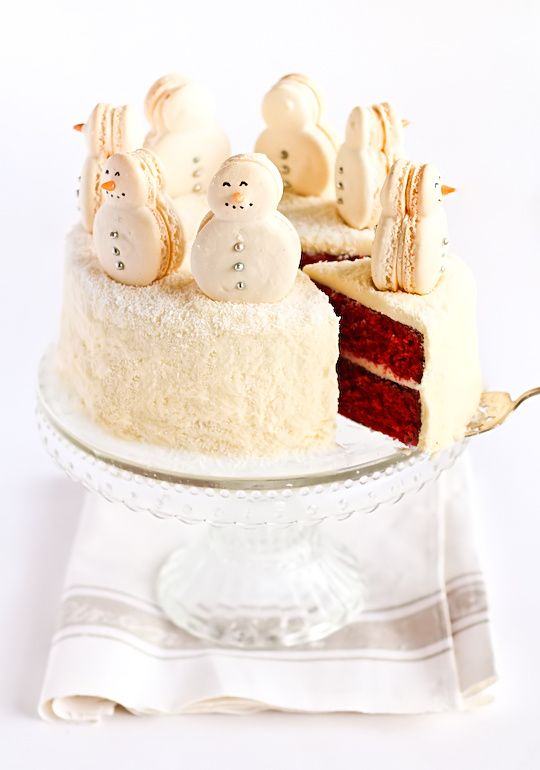 Red Velvet Cake with snowman Macarons! So adorable!